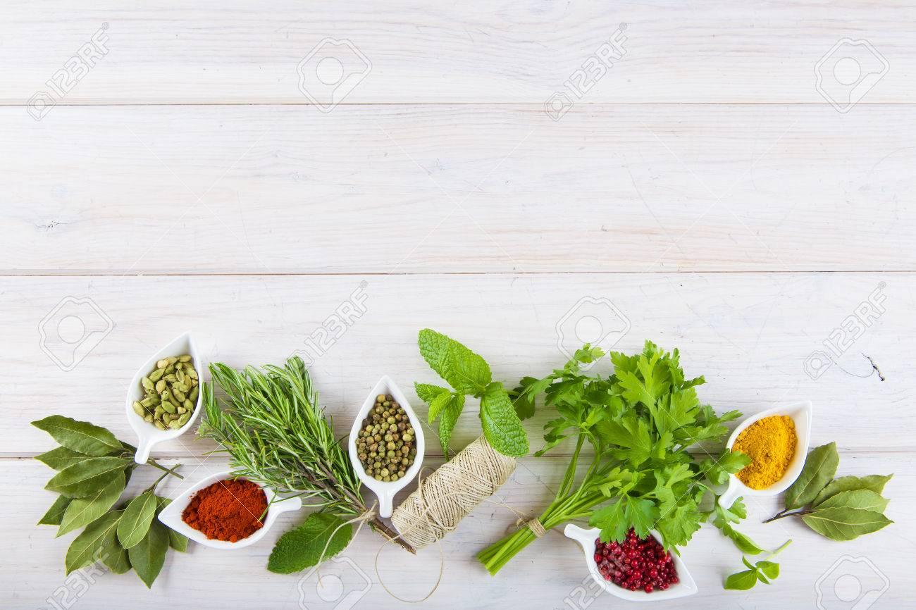 Fresh and colorful herbs and spices assortment on a white wooden background - 63075461