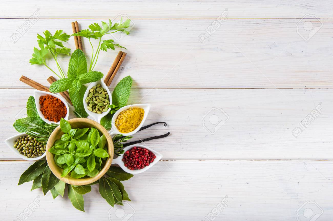 Fresh and colorful herbs and spices assortment on a white wooden background - 71881856
