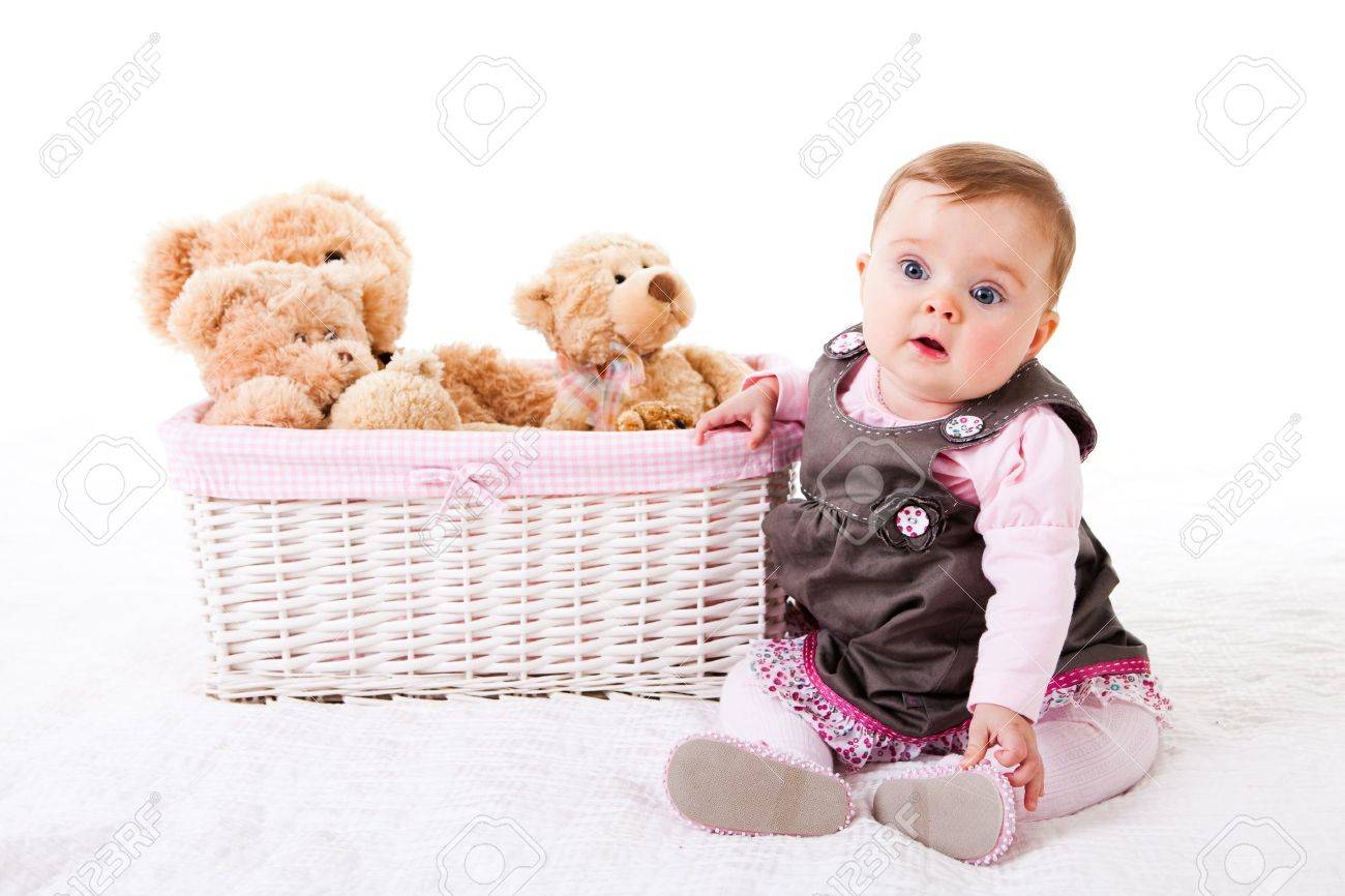 fcb4dde0d A Cute Baby Girl Is Sitting On The Floor Next To A Basket Of.. Stock ...