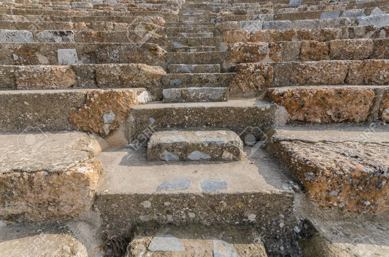 Rows of marble stone seats at ancient Greek theater at Ephesus