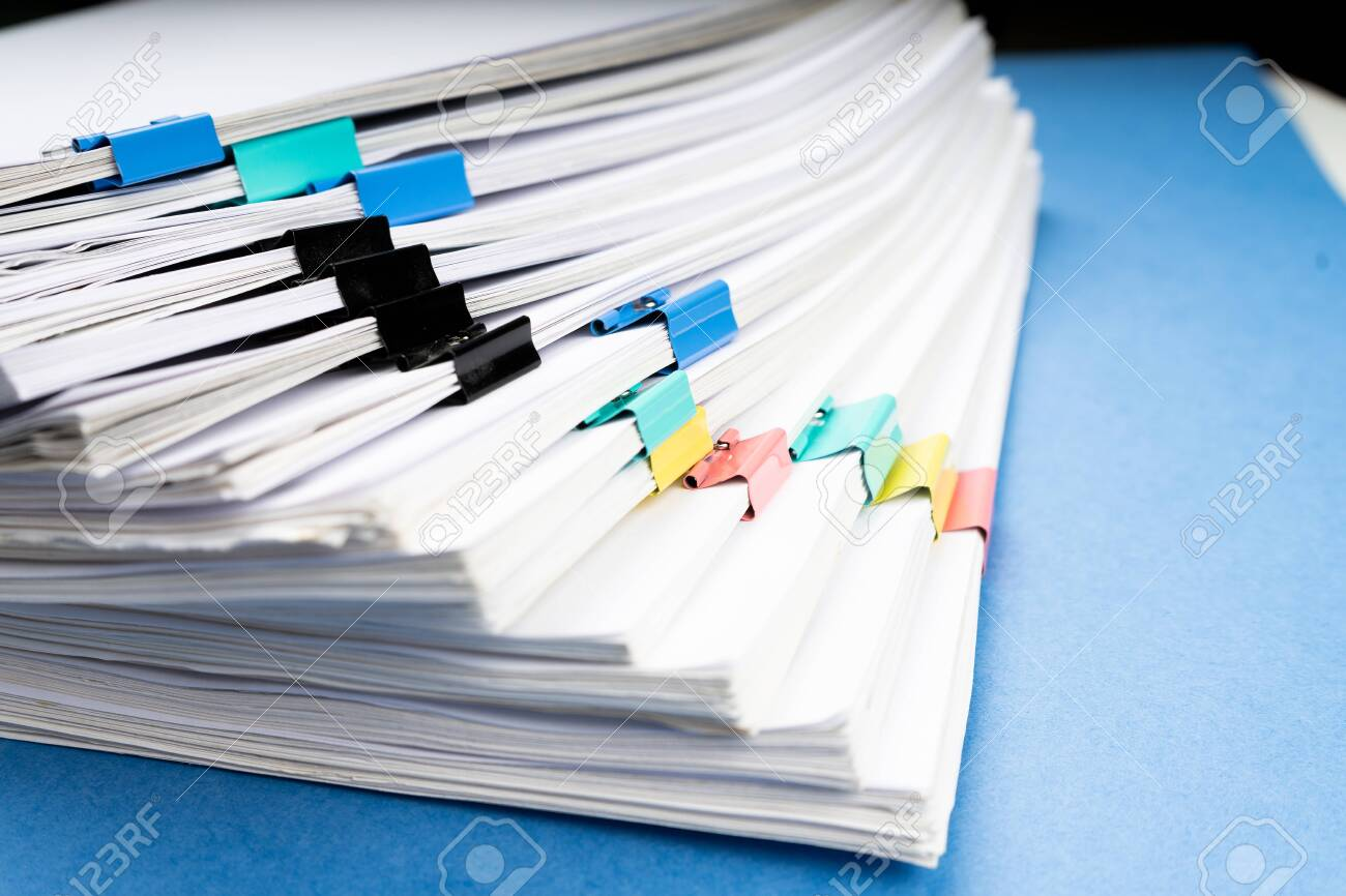 Mock up, stack of papers documents in archives files with paper clips on desk at offices, business concept. - 122588471