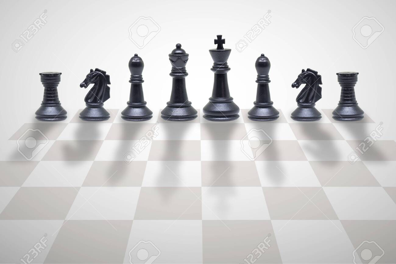 Business Competition Concept : Wooden chess pieces standing on chess board. - 128487219