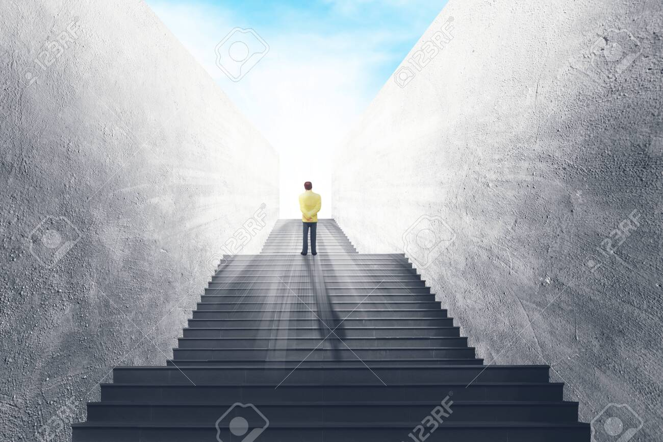 Business Vision and Success Concept : Businessman standing on concrete staircase and looking forward to sky. - 154193820