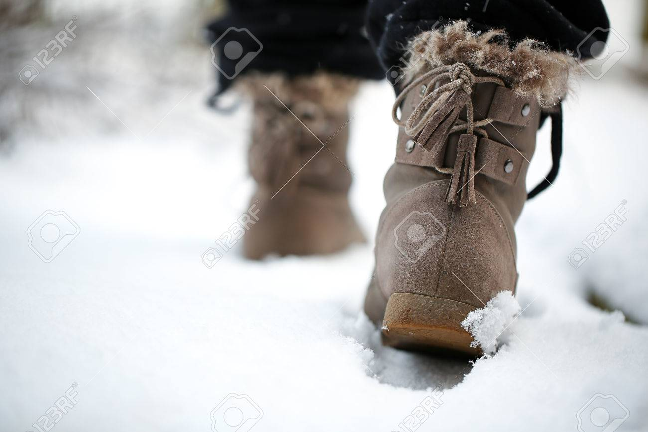 Girl Walking On The Snow With Boots In The Afternoon Stock Photo ...