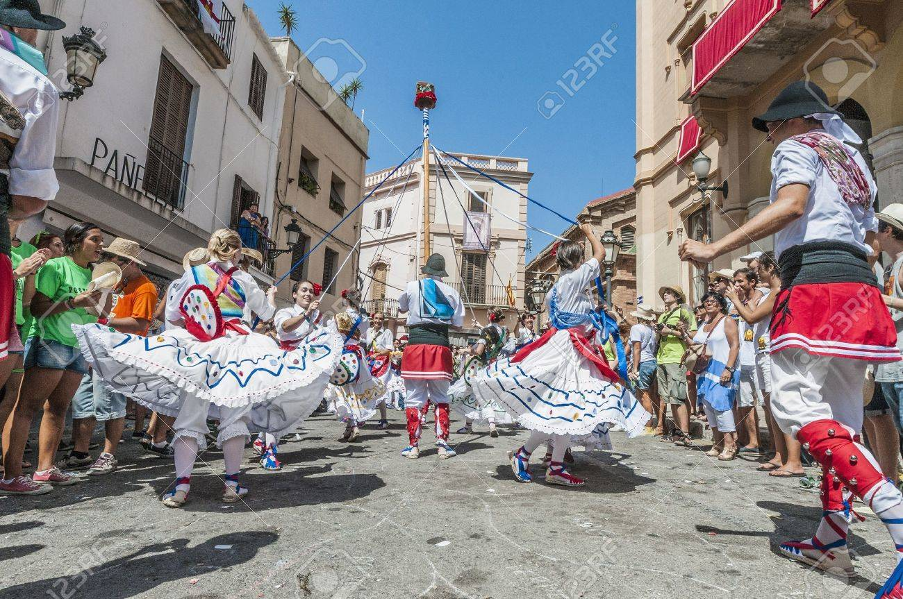SITGES, SPAIN - AUG 23: Ball de Gitanes group on Cercavila performance within the Festa Major celebrations Aug 23, 2012 in Sitges, Spain. Stock Photo - 17809525