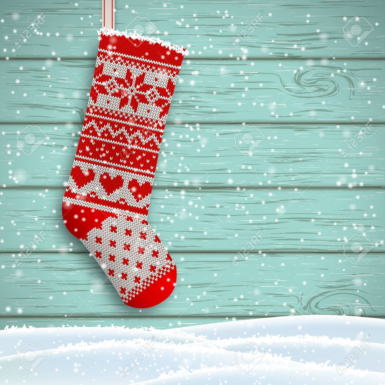 Knitted Christmas Stocking With Red Patterns On Blue Wooden ...