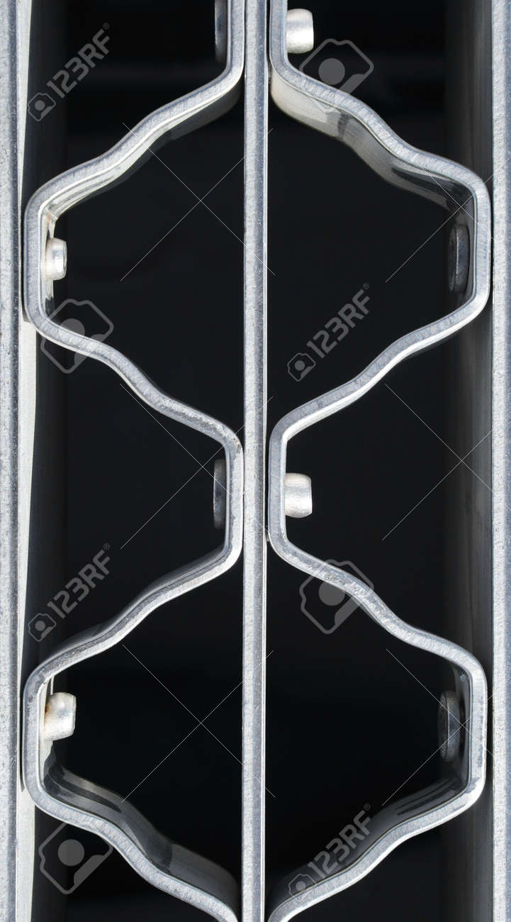 Wavy pattern of a metal grate with bolts. Stock Photo - 831576