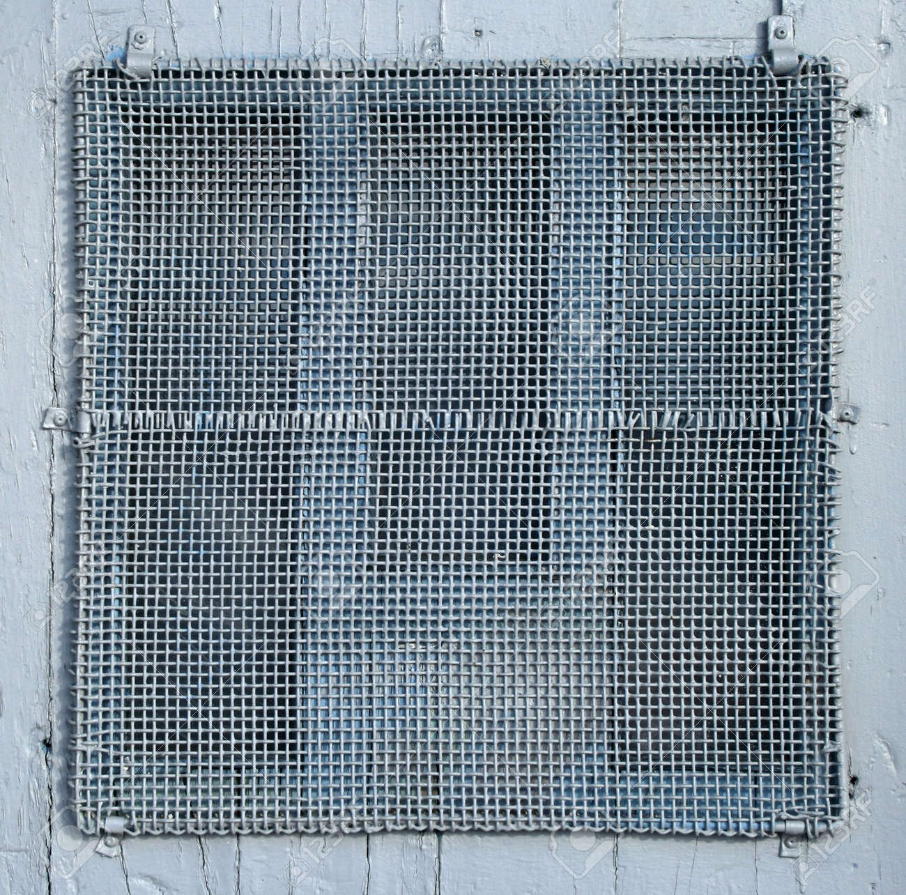 Painted Wire Mesh Covering The Window Of The Old Door. Stock Photo   831574