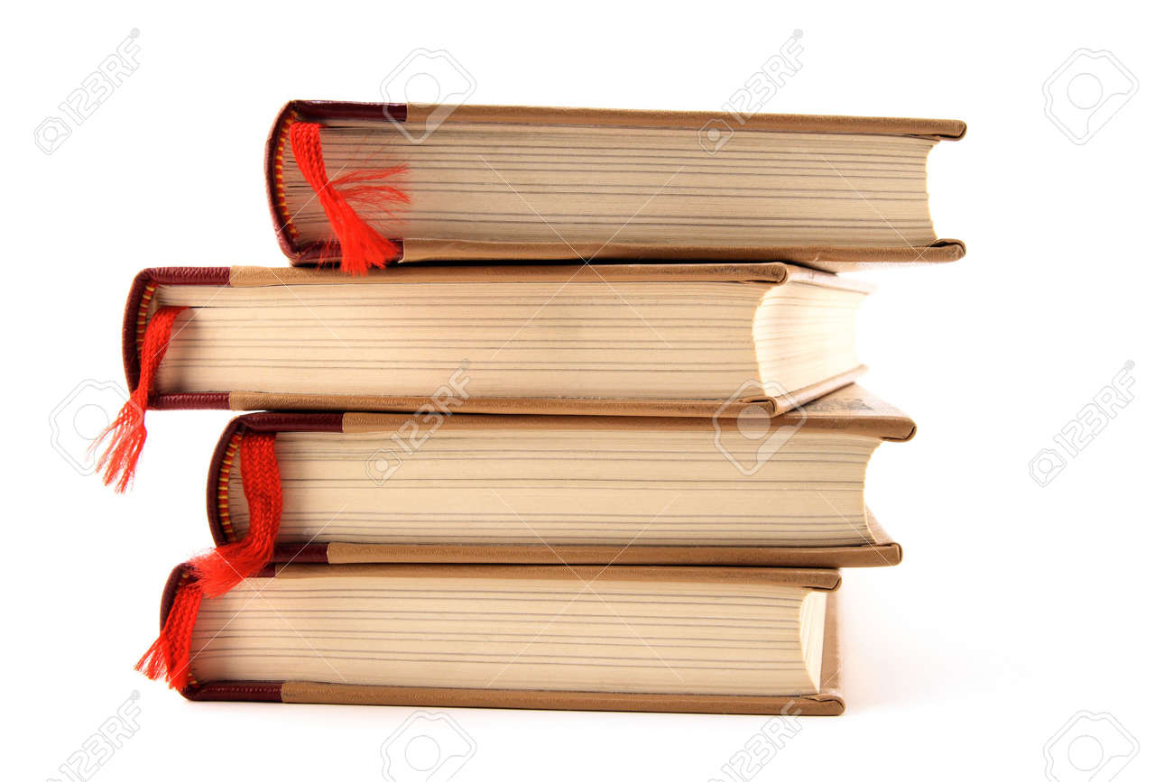 four stacked books with red bookmarks isolated on white background