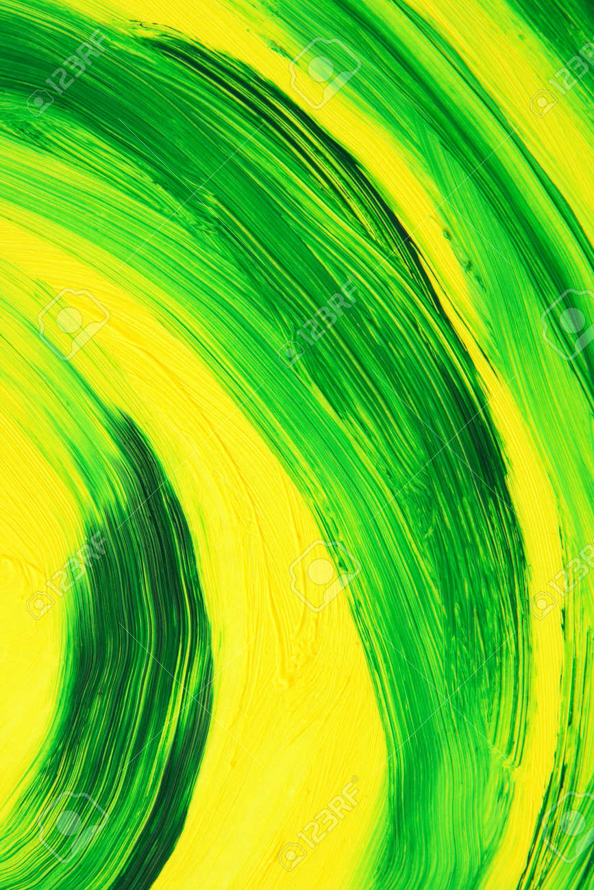 green and yellow oil-painted abstract curves. texture of brush