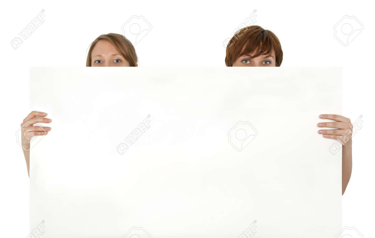 Two young women behind a blank banner ad, on white background. Stock Photo - 7747184