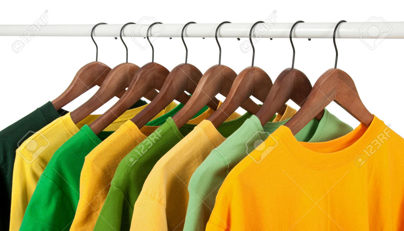 Choice of green and yellow shirts and t-shirts on wooden hangers, isolated on white. Stock Photo - 8321737