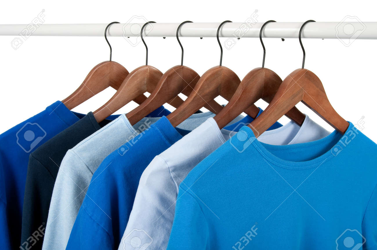 Choice of casual shirts on hangers, different tones of blue. Isolated on white. Stock Photo - 8321742