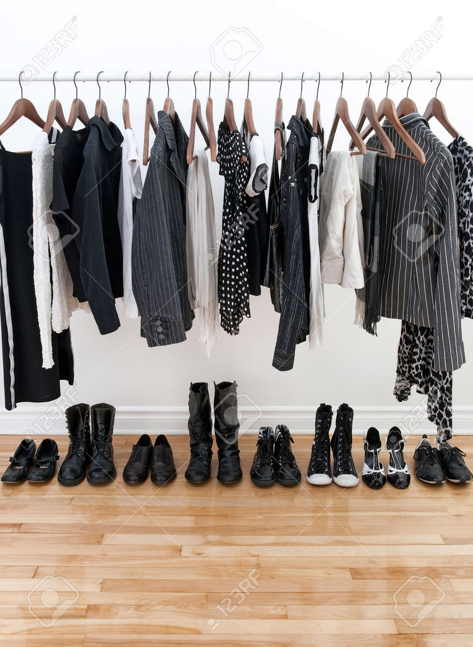 Black and white female clothes on hangers and shoes on a wooden floor. Stock Photo - 9071199
