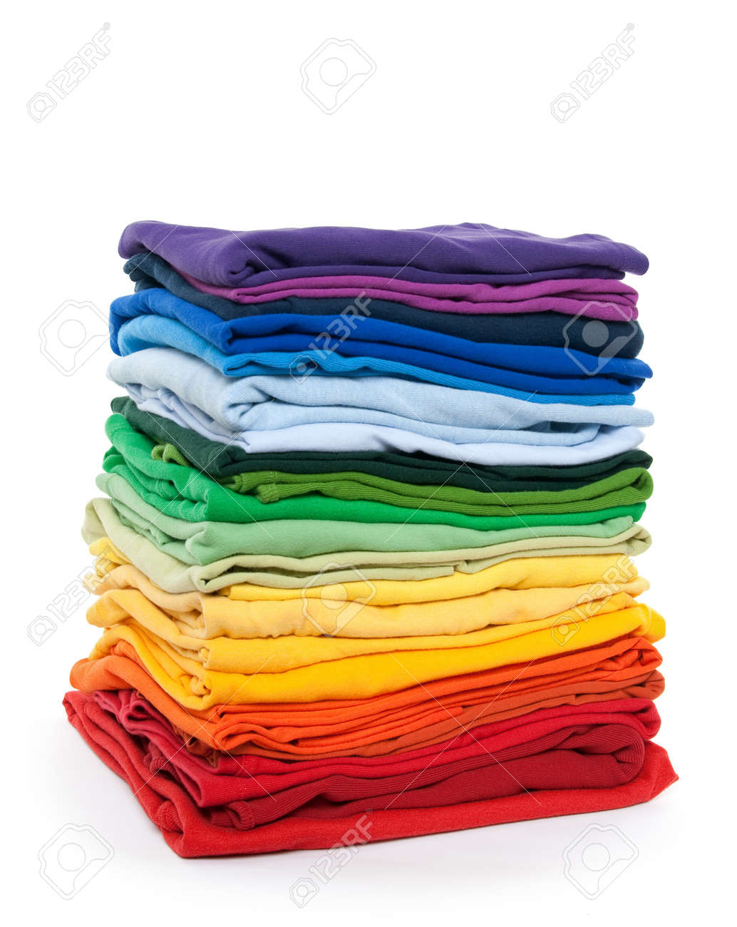 Rainbow clothes pile. Bright folded clothes on white background. Stock Photo - 9127307