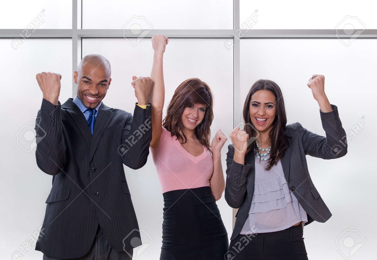 Winners. Happy and successful multicultural business team. Stock Photo - 9609406