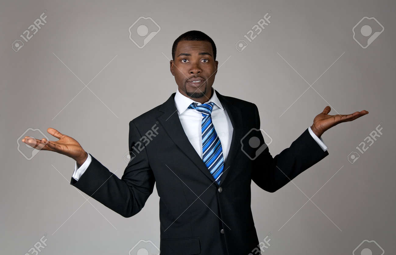 Expressive African American businessman looking puzzled and surprised. Stock Photo - 10763852