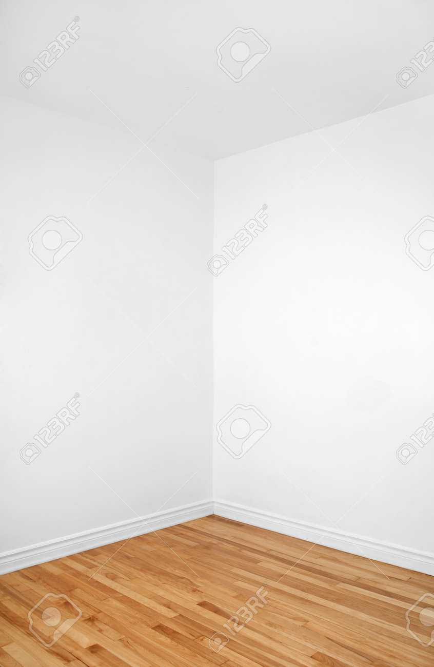 Empty corner of a renovated room with white walls and wooden floor Stock  Photo - 13111031