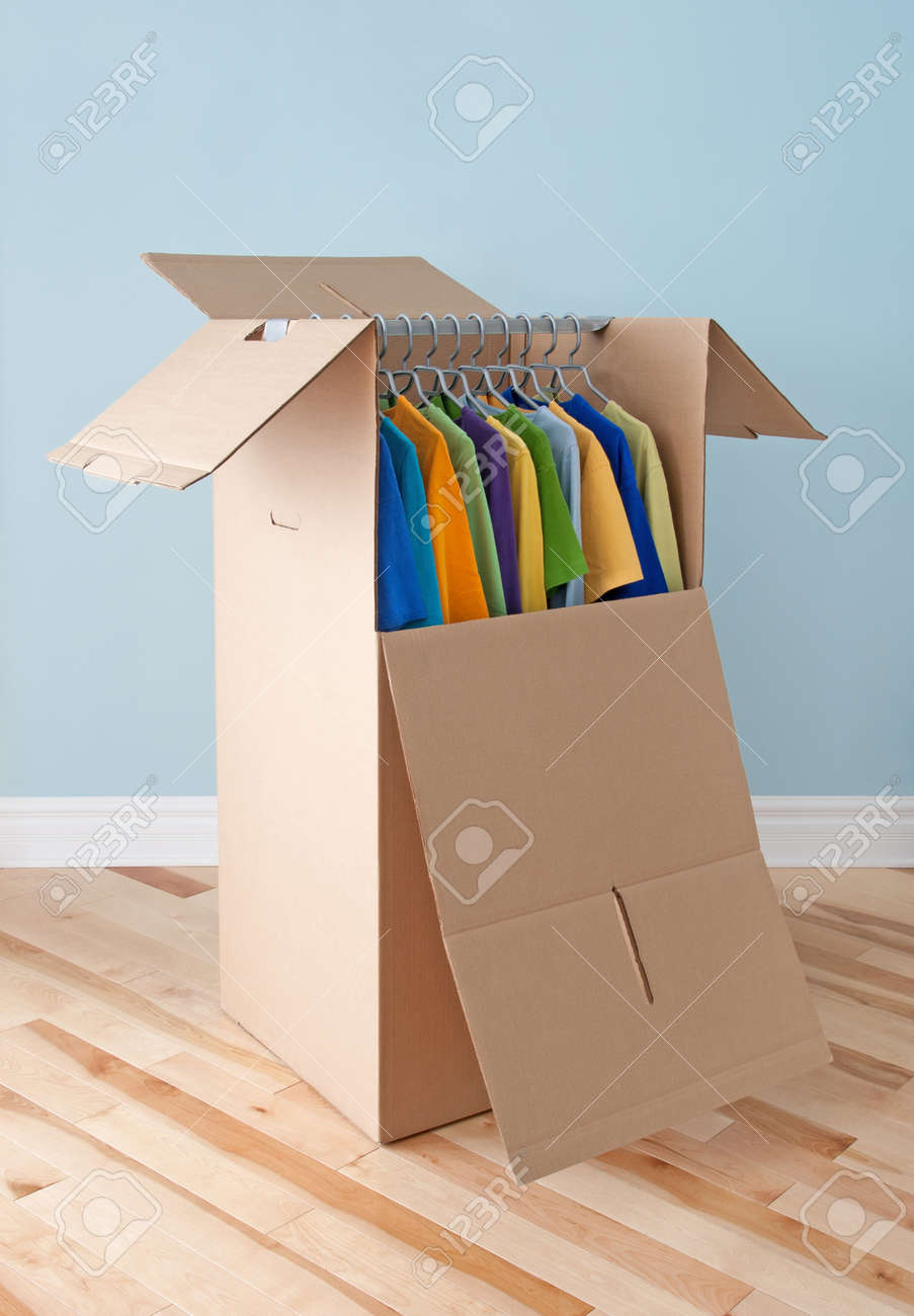 Wardrobe box filled with colorful clothing, prepared for transportation Stock Photo - 15013128