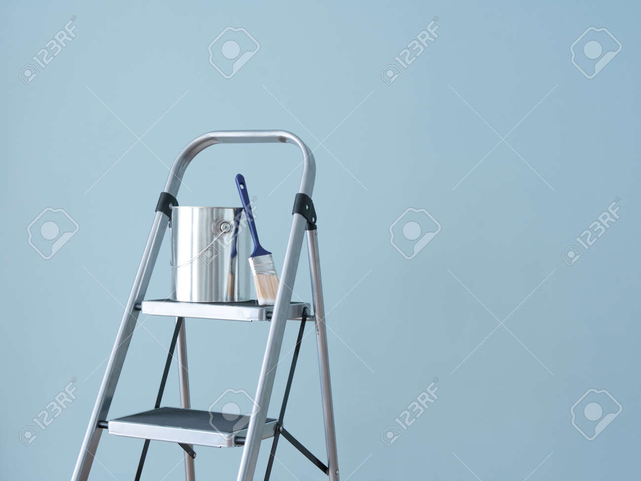 Preparing To Paint The Wall Painting Tools On A Metal Ladder