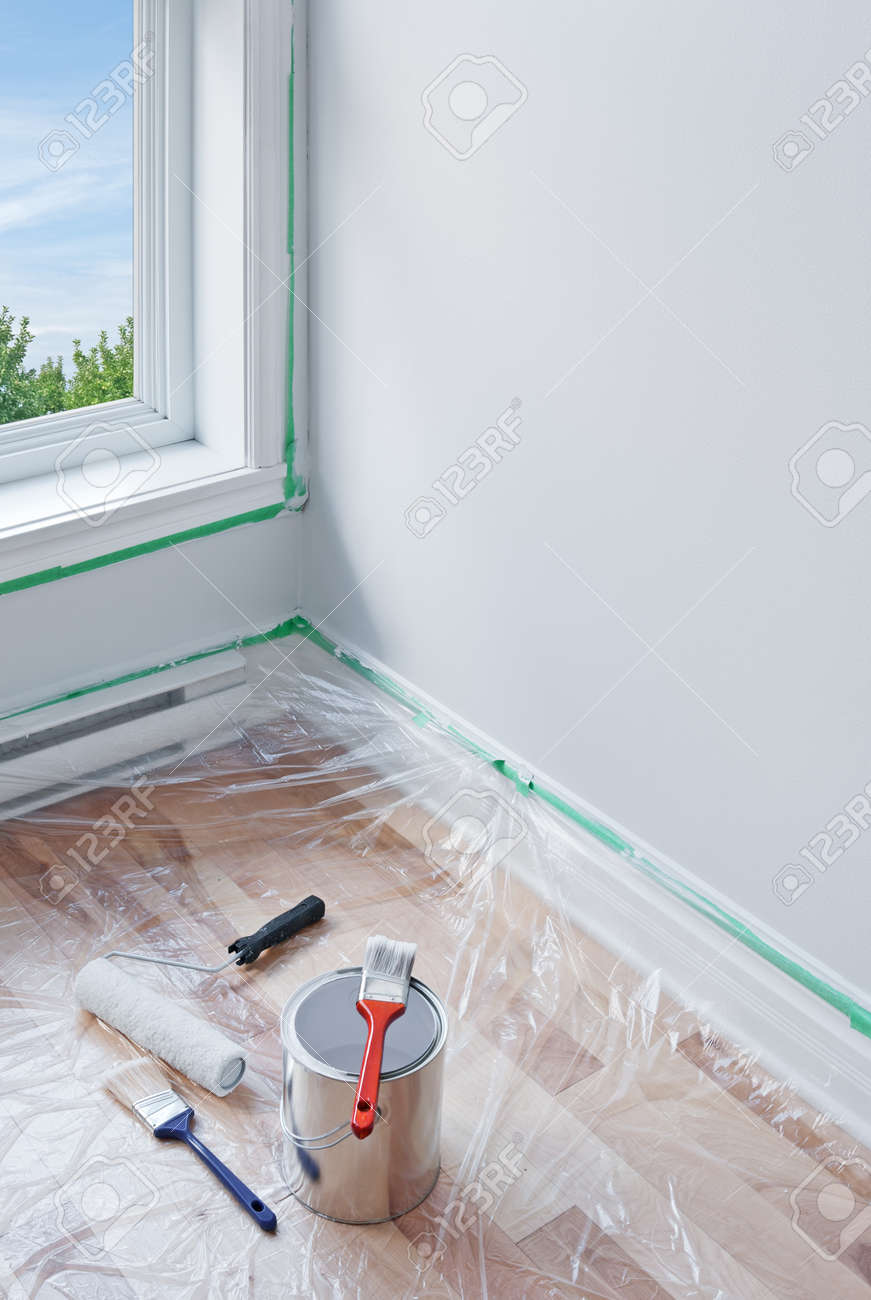 Renovations  Painting tools and floor protected by plastic Stock Photo - 15866596