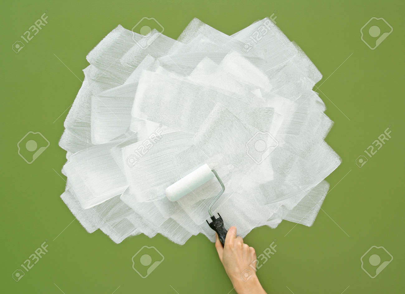 Painting Green Wall In White Color With Paint Roller Acrylic Stock