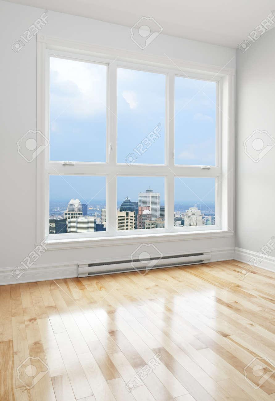 Big empty living room - City Skyscrapers Seen Through The Big Window Of An Empty Room Stock Photo 16368017