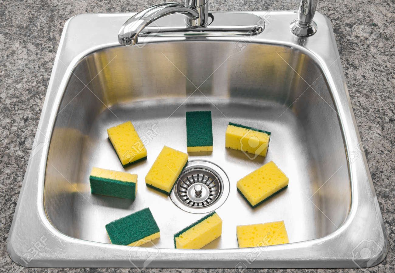 Lots Of Yellow And Green Sponges In A Clean Shiny Kitchen Sink Stock Photo 16674113