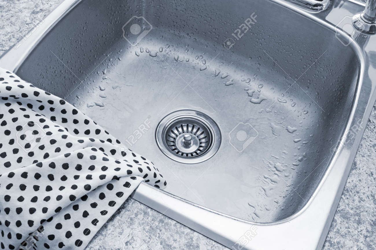 Clean Metal Sink And Polka Dot Kitchen Towel Stock Photo Picture