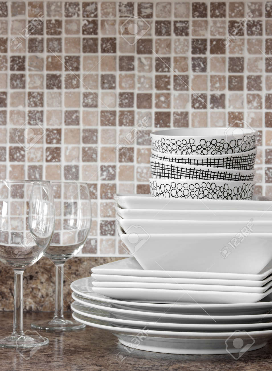 White dishes, plates and wineglasses on kitchen countertop Stock Photo - 17045044