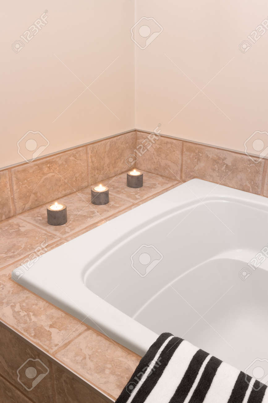 Bathroom With Modern Bathtub, Decorated With Candle Lights. Stock ...