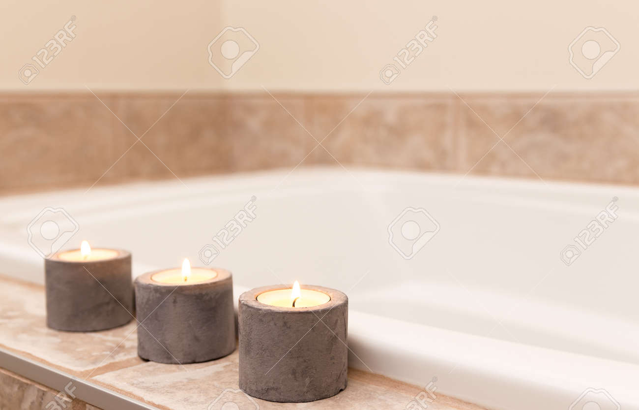 Stock Photo Three Candles In Concrete Candle Holders Decorating Bathroom