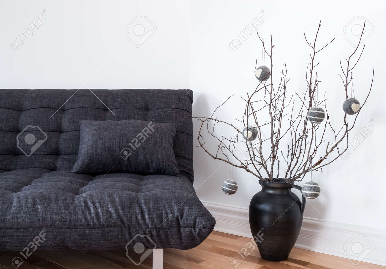 Gray sofa and simple winter decorations in the living room. Stock Photo - 17128058