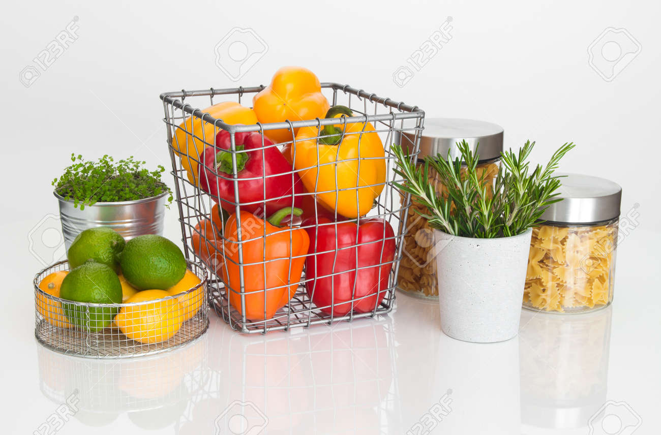 Colorful food ingredients on white background. Fruits, vegetables, pasta, herbs and green plant. Stock Photo - 17677410