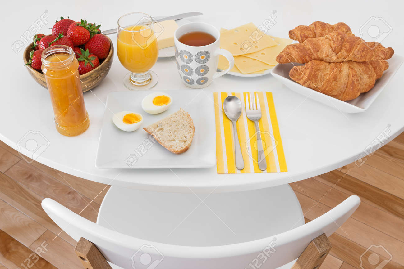 Breakfast is ready  White round table with healthy morning meal Stock Photo - 20732265