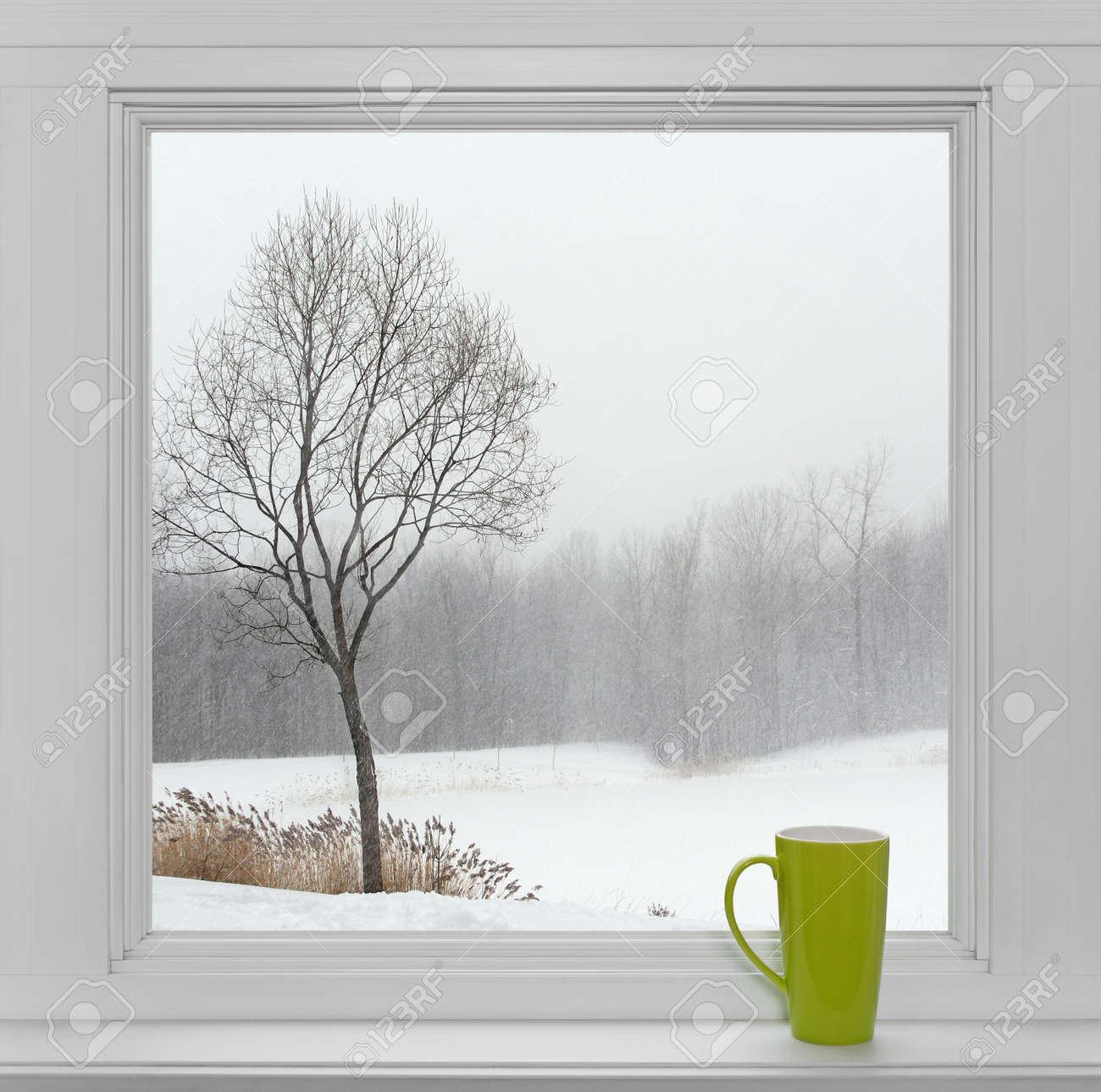 Modern window sill - Window Sill Green Teacup On A Windowsill With Winter Landscape Seen Through The Window