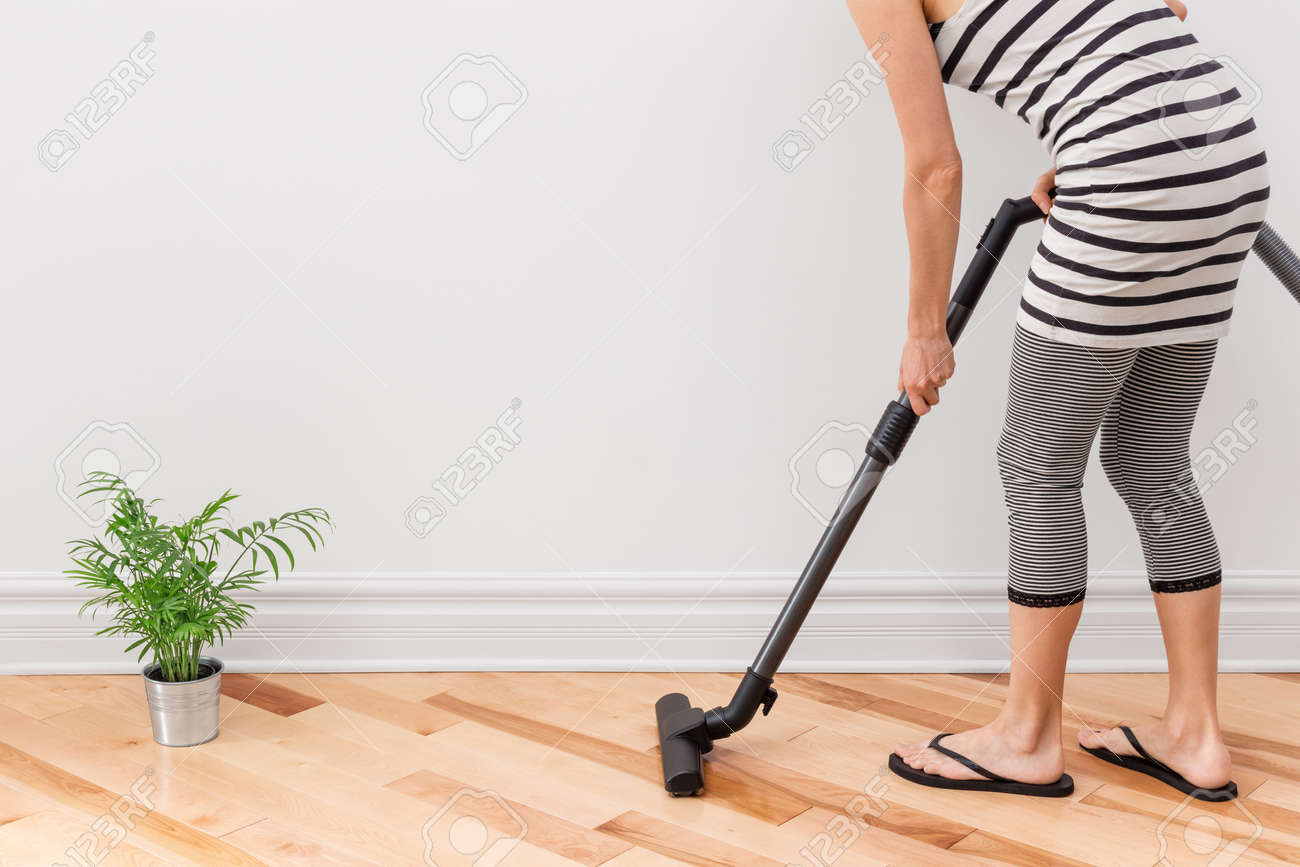 Housework Young Woman Vacuum Cleaning The Apartment Stock Photo   22794327