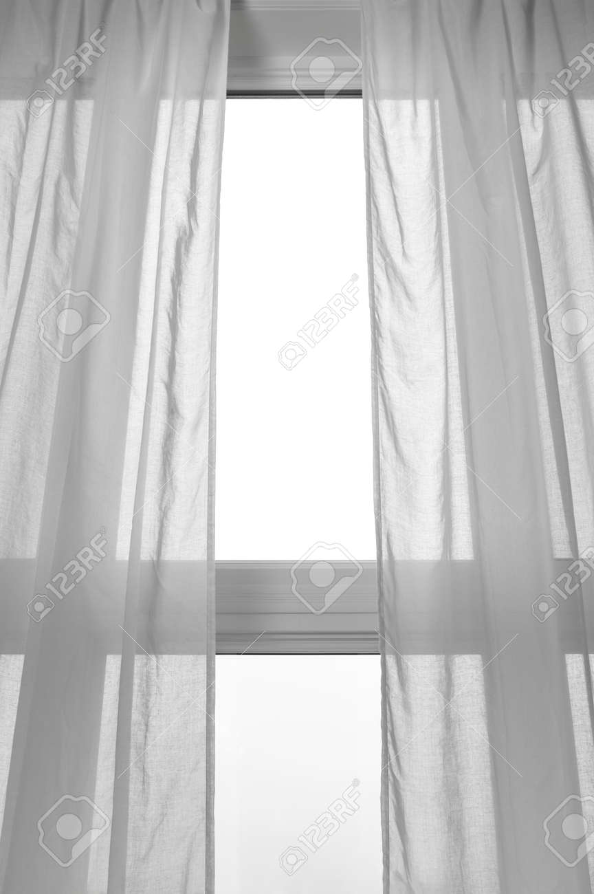 Light Coming Through The Window With White Transparent Curtains