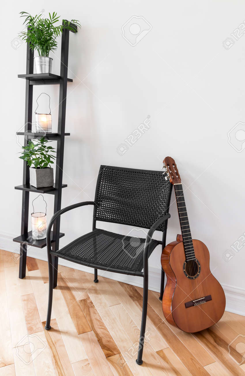 Room With Simple Black Furniture, Plants And Classical Guitar Stock ...