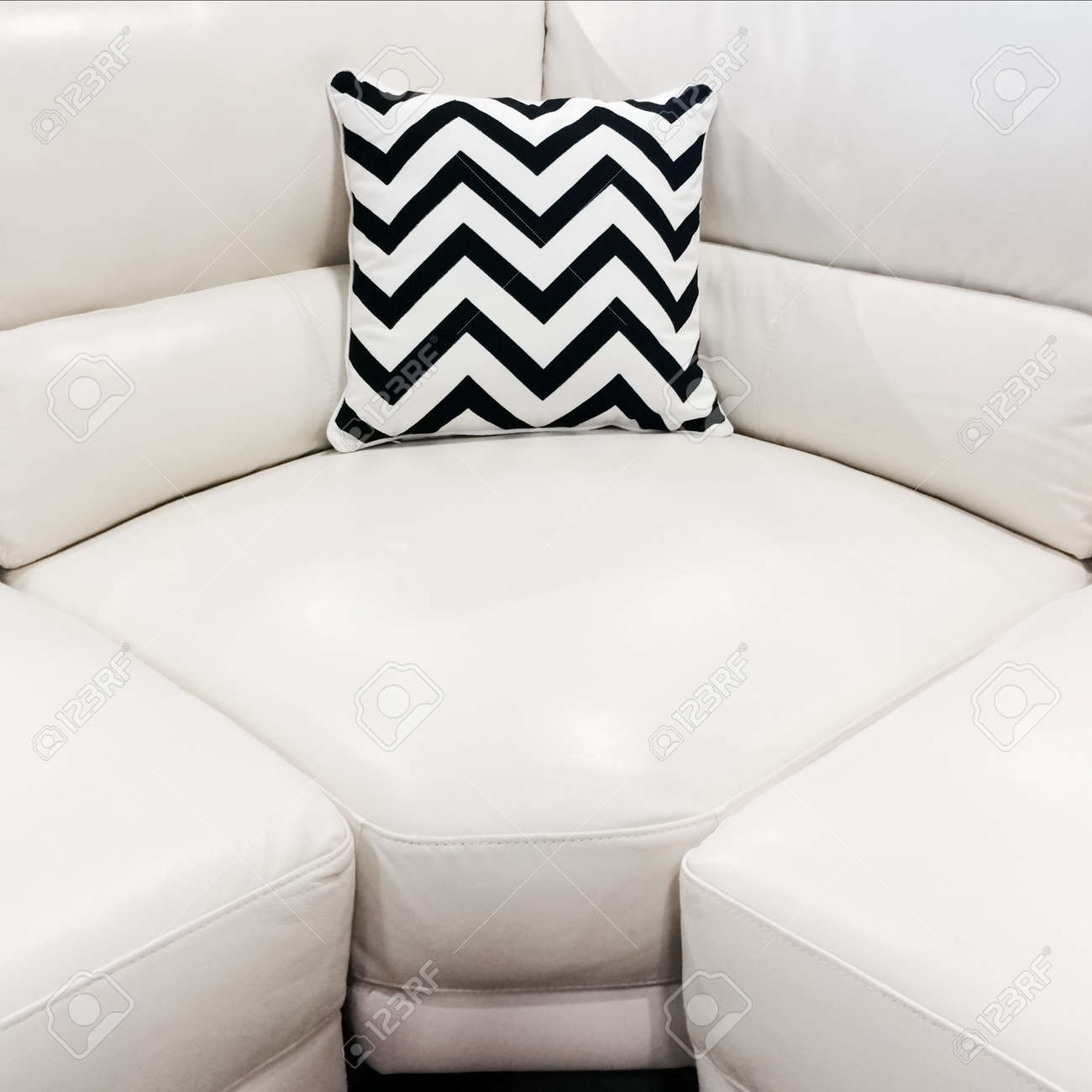 Awe Inspiring White Leather Sofa With Striped Decorative Cushion Modern Furniture Ncnpc Chair Design For Home Ncnpcorg