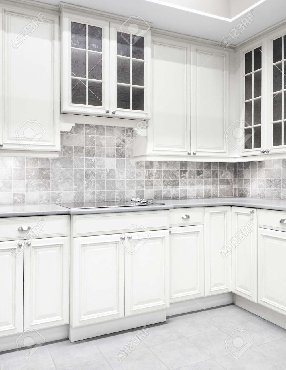 Contemporary Kitchen With White Cabinets And Tiled Walls Stock Photo Picture Royalty Free Image 33028381