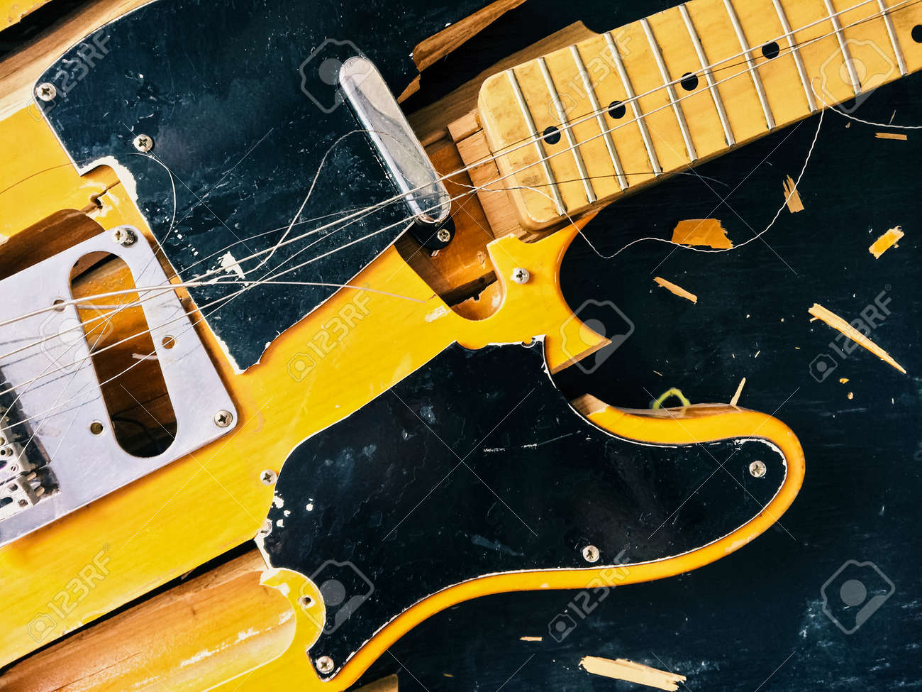 Old broken electric guitar, falling to pieces. - 51436869
