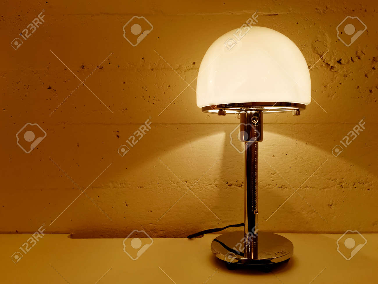 Table Lamp Giving Warm Orange Light Contemporary Design Stock Photo Picture And Royalty Free Image Image 78534654