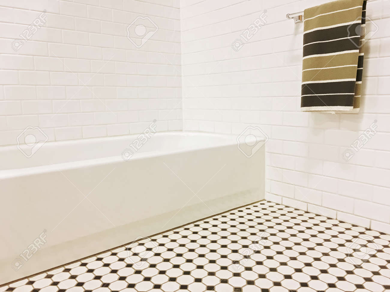 New Bathroom With Black And White Ceramic Tile Decor And A Striped ...