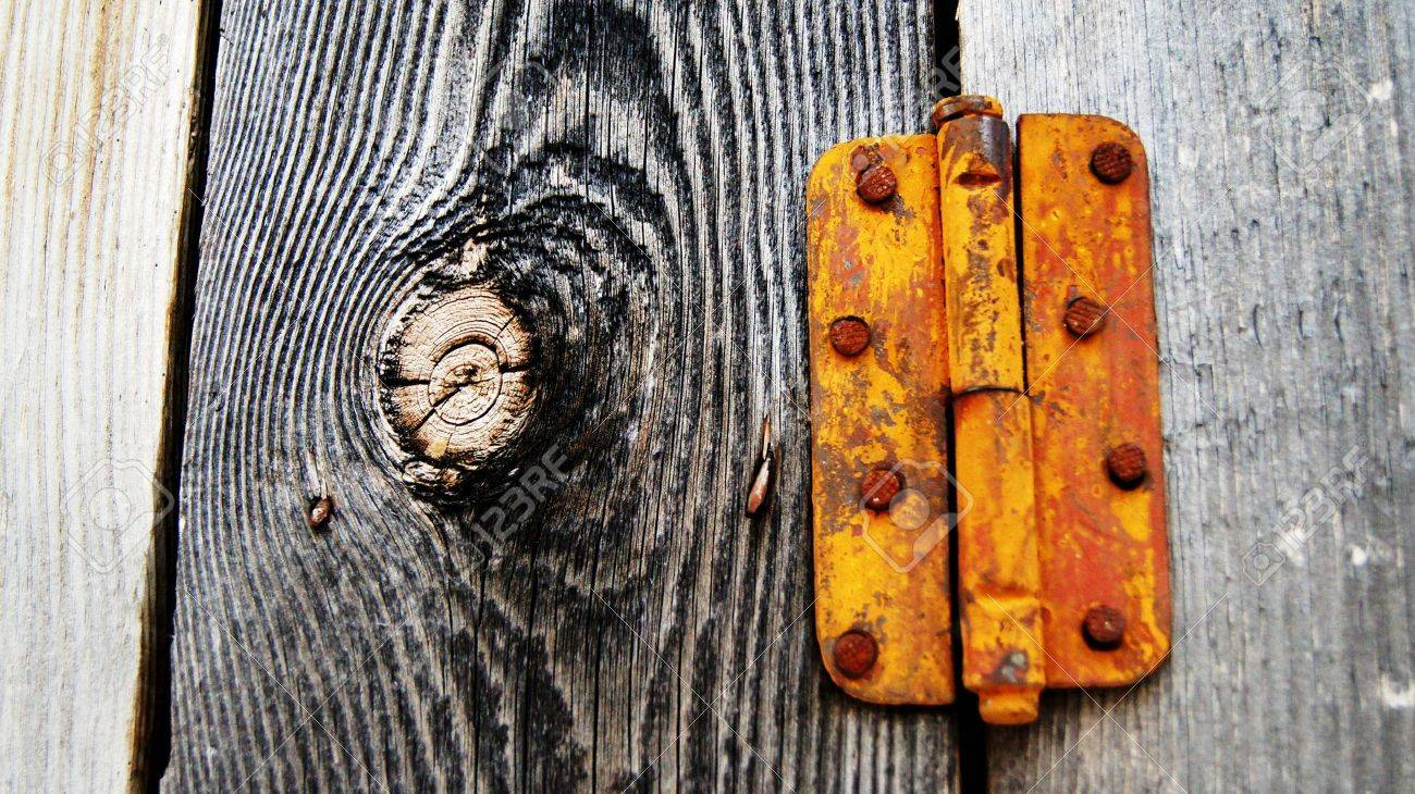 Rusty Door old rusty door hinge on a wooden gate stock photo, picture and