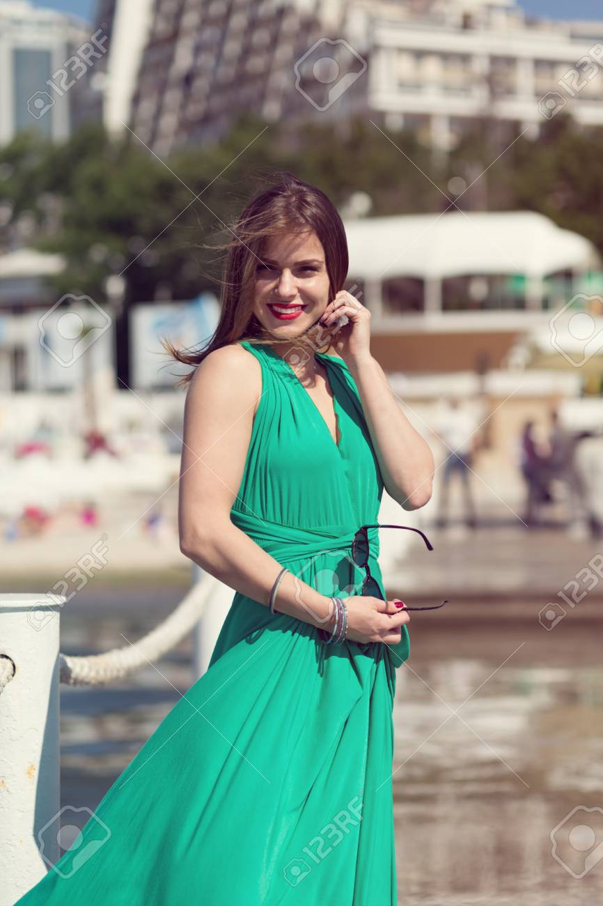 Beautiful girl standing on a pier. Retro look image Stock Photo - 41061362 7573690792fa