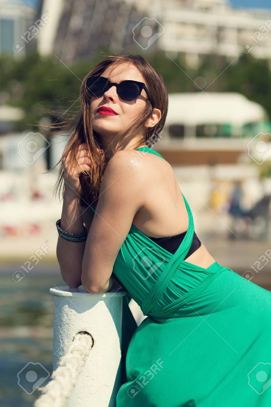 Beautiful girl standing on a pier. Retro look image Stock Photo - 41061449 13c175c42933