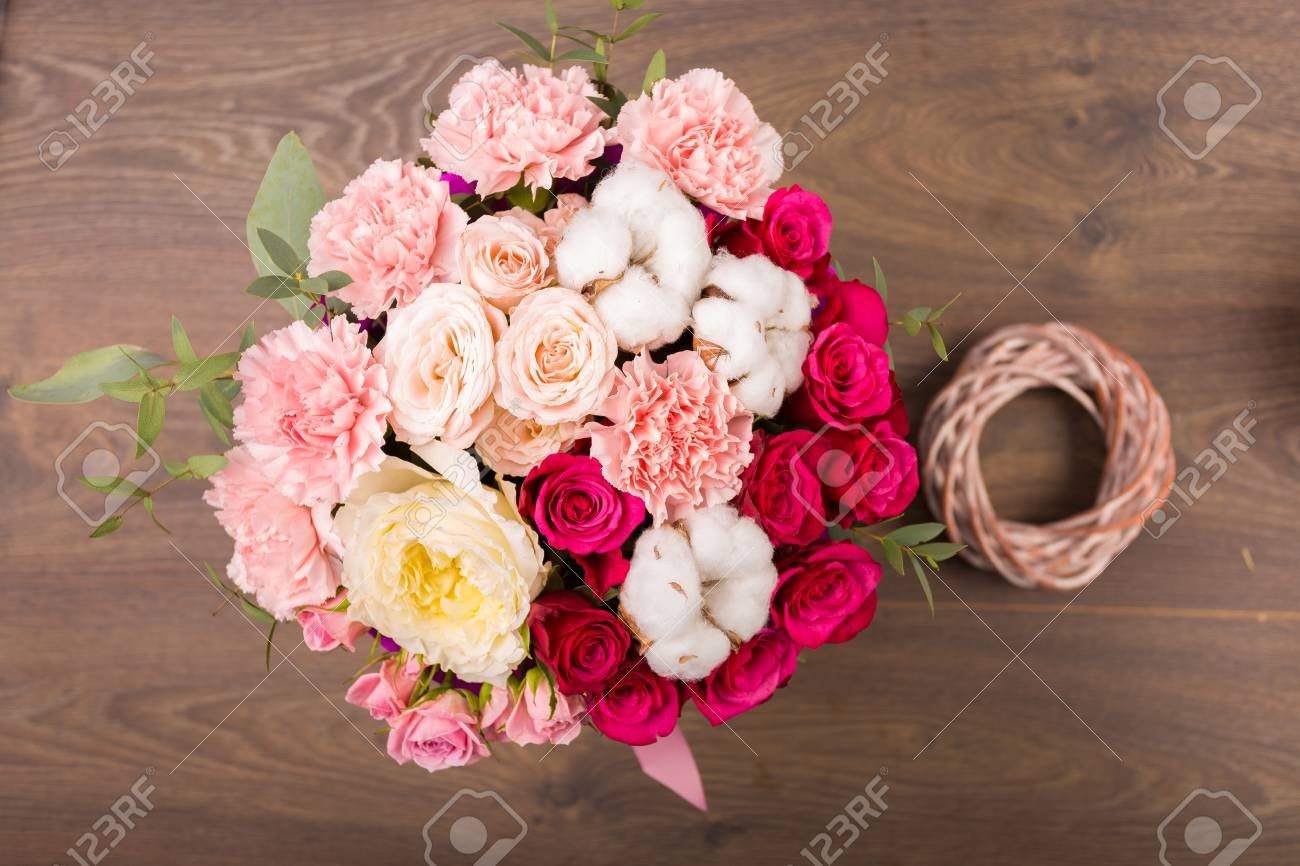 Vintage Flower Bouquet On A Wooden Background Stock Photo, Picture ...