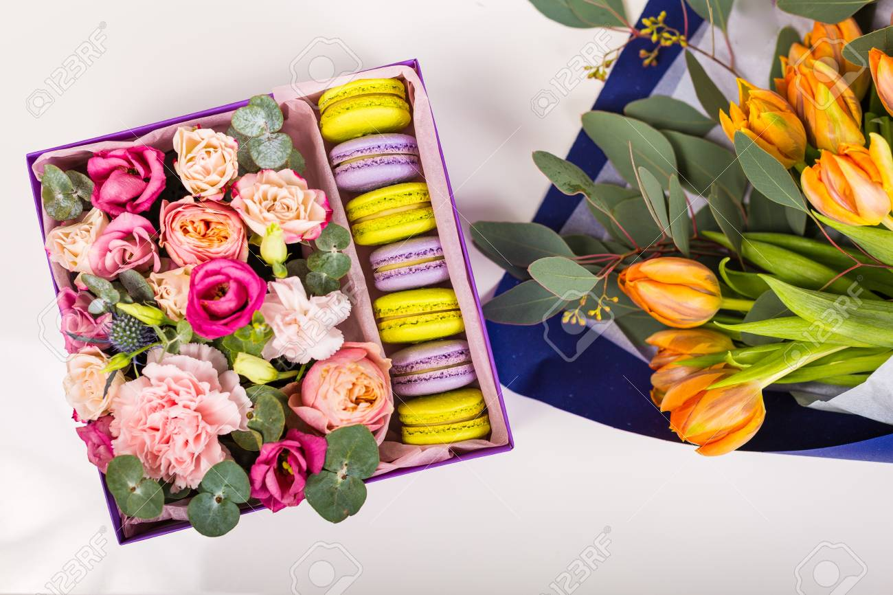 Beautiful Flowers And A Gift Box With Macaron Cookies Stock Photo ...