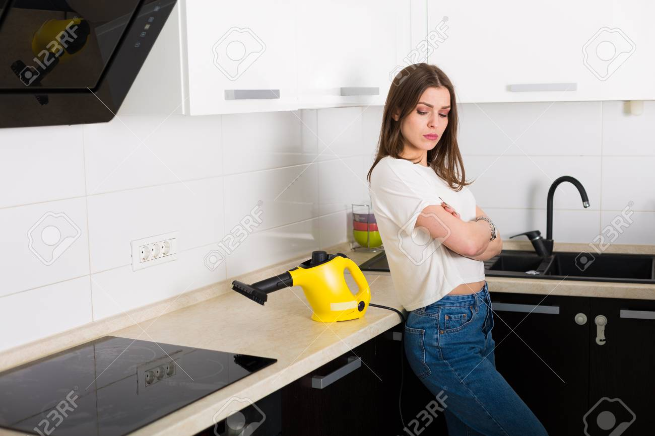 Young Beautiful Woman Cleaning Kitchen With Steam Cleaner Stock Photo Picture And Royalty Free Image Image 76145711